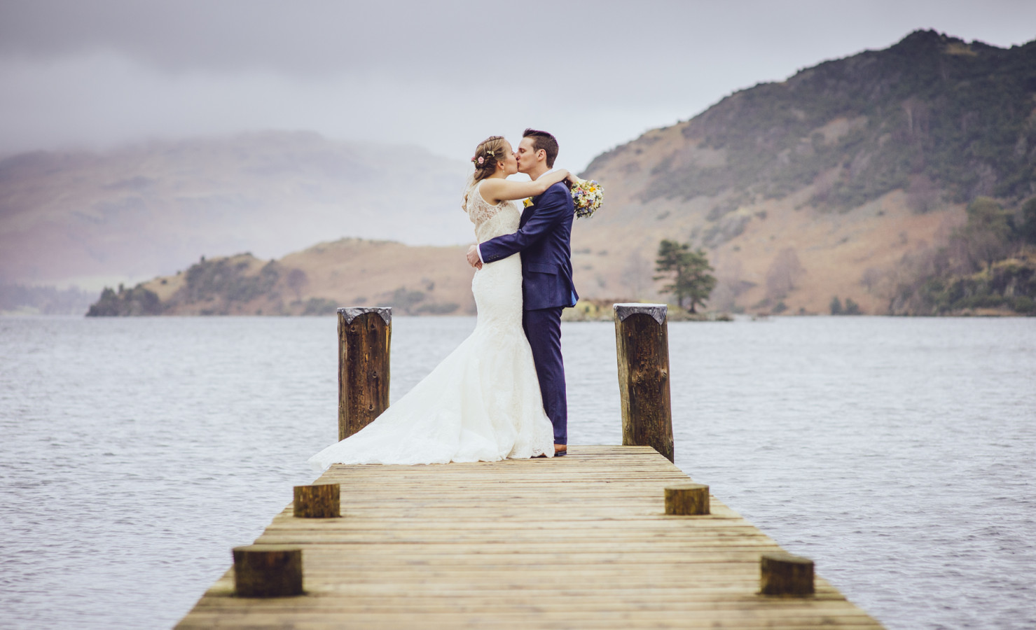 Bride and groom embrace next to the lake, classic and timeless photography by luke