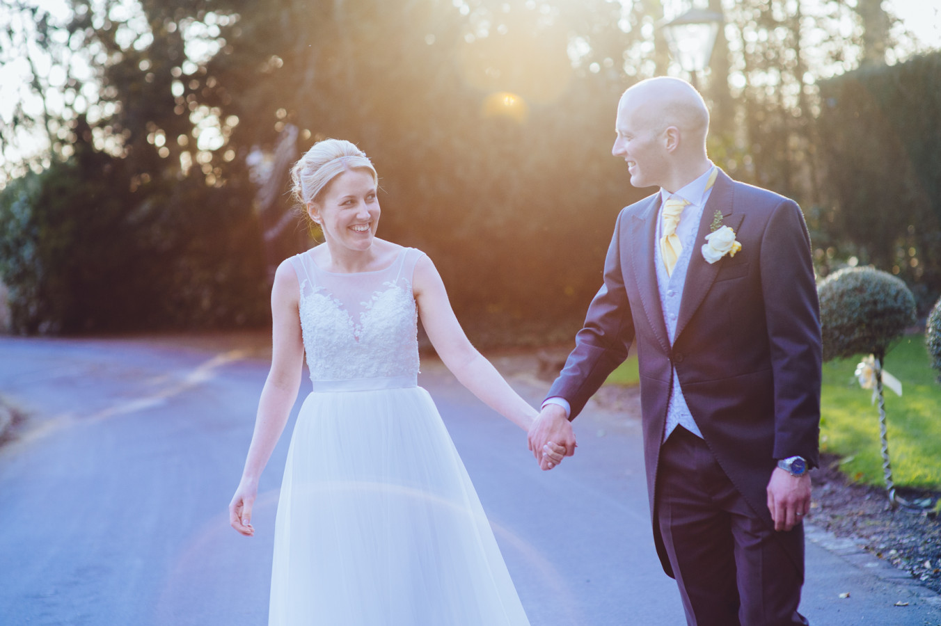 Bride & Groom walk hand in hand at Bartle Hall. Natural Wedding Photography by Luke